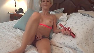 Amateur MILF takes on two dildos and then her hubby's cock