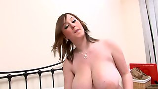 Curvy Malibu loves to flash her huge melons on camera
