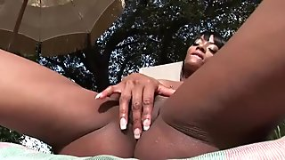 Hot ebony babe masturbates by the pool