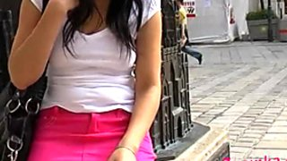 Cuddly brunette girl shows her tight pussy in public