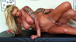 Inked hottie Brooke gets fucked in the tattoo parlor