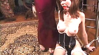 Bound and gagged brunette cutie gets whipped by a skinny