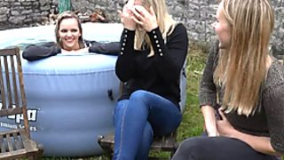 3 girls in jeans having wetlook fun in an inflatable pool 2