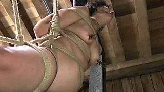 Cunning bondage master whips his slave's plump ass nice and hard