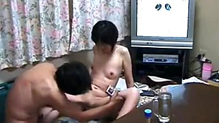 Mature japanese couple makes a sextape in the living room