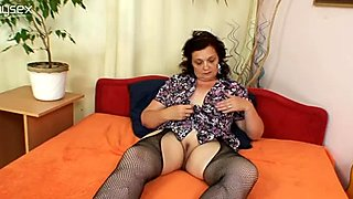 Ugly fat bitch Teryna in fishnet stockings fucks her snatch with dildo