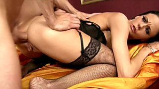 Perky brunette MILF in fishnets gets an anal creampie