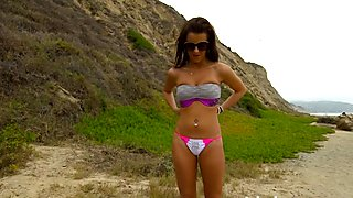 Young petite brunette runs naked at the beach and plays with herself
