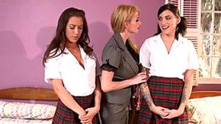 Horny teacher Capri Cavanni punishes her naughty big assed students