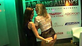 Wet clubbers dancing erotically