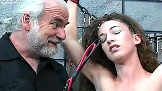 Tied up and humiliated curly girl is punished by old man