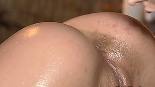 Masseuse fungers beautiful busty brunette babe