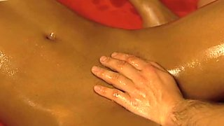 Horny masseur gives sensual massage before fingering wet pussy