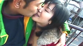 Cute and dirty Japanese exhibitionist fucks in doggy style on the roof