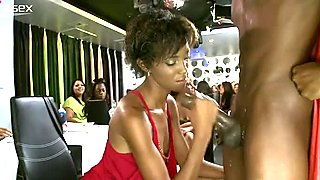 Attractive ebony girl is sucking stripper's hard cock on a party