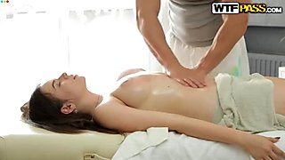 Busty black haired babe got her oiled kitty massage by cute brutal guy