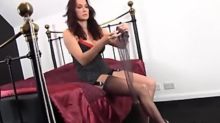 Hot Milf slips her sexy long legs inside new pair of silky nylon stockings