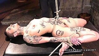 Hogtied inked slave tormented