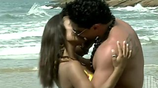 The couple gets horny on a beach and start fucking fiercely