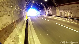 Playful petite babe gives a nice blowjob in the tunnel